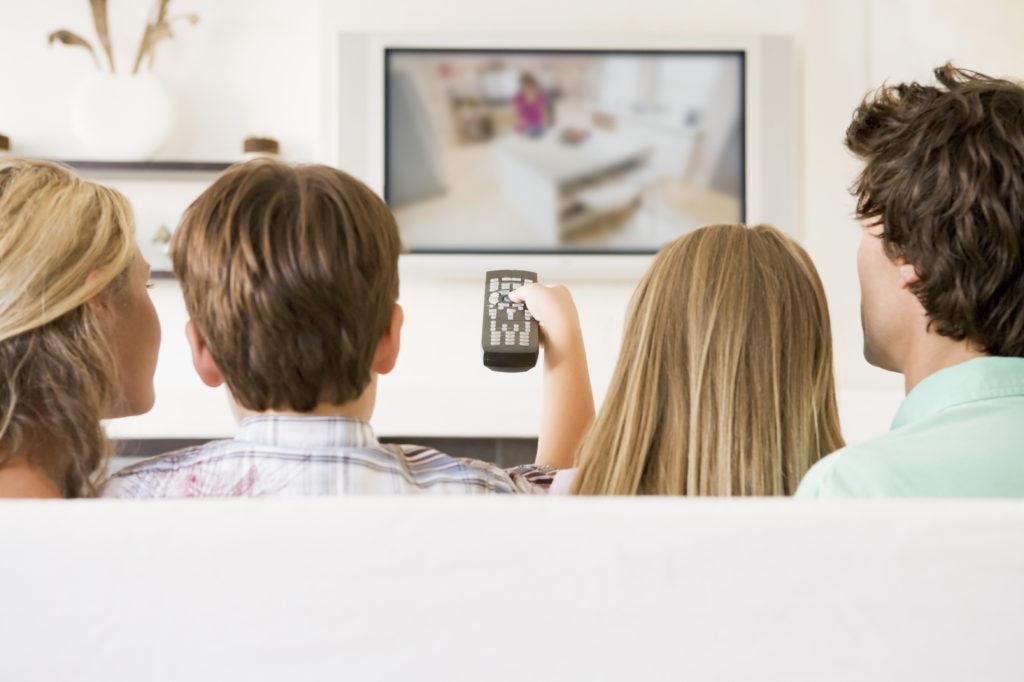 Family Watching TV-Large
