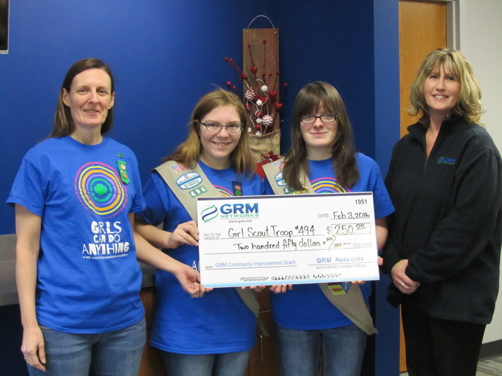 Pictured from left to right: Troop 494 Leader Tricia Rudminat, Amber Lawson, Gillian Sapp and GRM Networks® CSR Donna Lutzen.