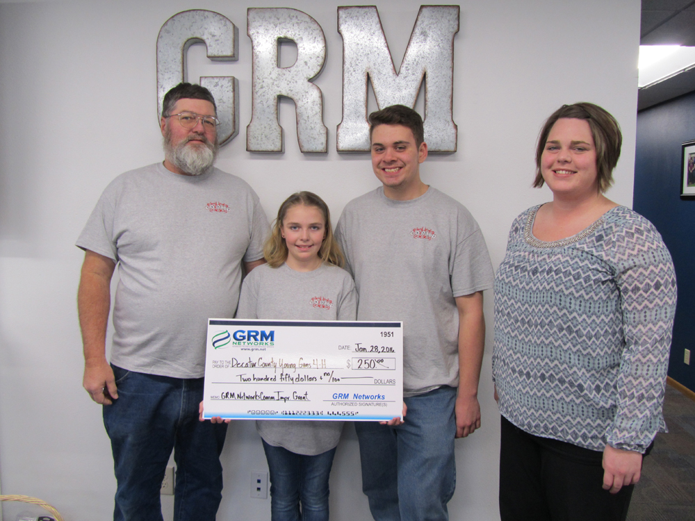 Pictured from left to right: 4H Shooting Sports Director Gene Olsen, Courtney Olsen, Roland Deason and GRM Networks® CSR Melanie Shields.